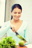 Beautiful woman in the kitchen — Stock Photo