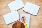 Close up of female hands writing to notebook — Stock Photo