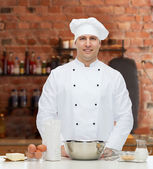 Happy male chef cook baking — Stock Photo