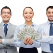 Group of business people with dollar cash money — Stock Photo #71722835