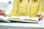 Close up of female hands to book or textbook — Stock Photo