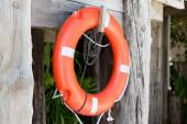 Lifebuoy or life preserver hanging on rescue booth — Stockfoto