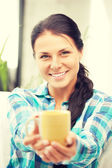 Lovely housewife with mug — Stock Photo