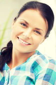 Picture of smiling woman at home — Stock Photo