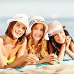 Girls sunbathing on the beach — Stock Photo #71958473