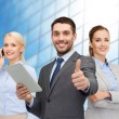 Group of smiling businessmen showing thumbs up — Stock Photo #71959195