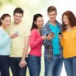 Group of smiling teenagers with smartphones — Stock Photo #71959771