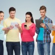 Group of teenagers with smartphones and tablet pc — Stock Photo #71959783