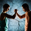 Two young men arm wrestling — Stock Photo #71959985