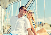 Smiling couple sitting on yacht deck — Stock Photo
