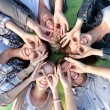 Group of students or teenagers lying in circle — Stock Photo #71960529