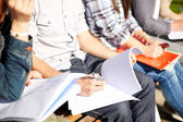 Close up of students with notebooks at campus — Stock Photo
