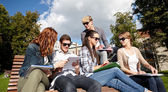 Group of happy students with notebooks at campus — Стоковое фото