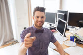 Happy male office worker pointing finger at you — Stockfoto