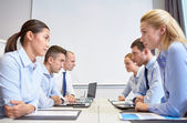 Smiling business people having conflict in office — Stock Photo