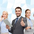 Group of smiling businessmen showing thumbs up — Stock Photo #72297957