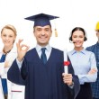 Happy bachelor with diploma over professionals — Stock Photo #72299989