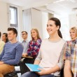 Group of smiling students in lecture hall — Stock Photo #72300651