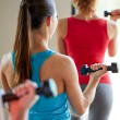 Close up of women with dumbbells in gym — Stock Photo #72300765