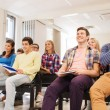 Group of smiling students in lecture hall — Stock Photo #72300933