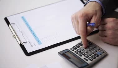 Close up of businessman with papers and calculator — Stock Video