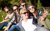 Students or teenagers with smartphone at campus — Stock Photo