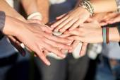 Close up of people hands on top — Стоковое фото