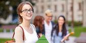 Happy teenage students with school folders — Stock Photo