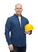 Smiling man in helmet with gloves — Stock Photo