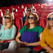 Happy friends watching movie in 3d theater — Stock Photo #72678691