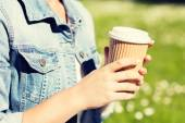Close up of young girl with coffee cup outdoors — Stock Photo