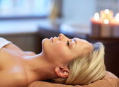 Close up of young woman lying in spa — Stock Photo
