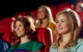 Happy friends watching movie in theater — Stock Photo