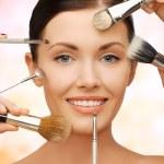 Happy woman applying professional make-up — Stock Photo #72994019