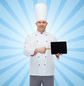 Happy male chef cook showing with tablet pc — Стоковое фото