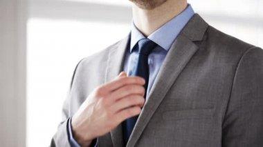 Close up of man in suit adjusting necktie — Video Stock
