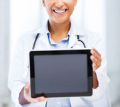 African female doctor with tablet pc — Stock Photo