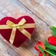 Close up of red tulips and chocolate box — Stock Photo #73170687