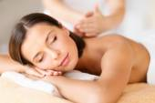 Beautiful woman in spa salon getting massage — Stock Photo