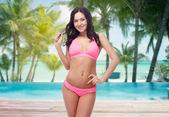 Happy young woman in pink bikini swimsuit — Stock Photo