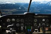 Dashboard in airplane cockpit and mountains view — Stock Photo