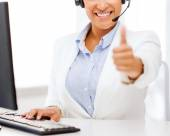 African female helpline operator showing thumbs up — Stock Photo
