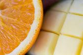 Close up of fresh juicy orange and mango slices — Stock Photo