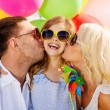 Family with colorful balloons — Stock Photo #73377299