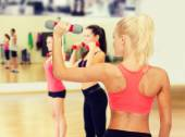 Young sporty woman with light dumbbell — Stock fotografie