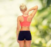 Sporty woman touching her neck — Stock Photo