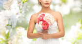 Bride or woman with bouquet of flowers — Stock Photo