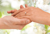 Close up of man and woman hands with wedding ring — Stock Photo
