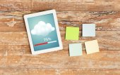 Stickers and tablet pc transferring data — Stock Photo