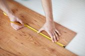Close up of male hands measuring flooring — Stock Photo